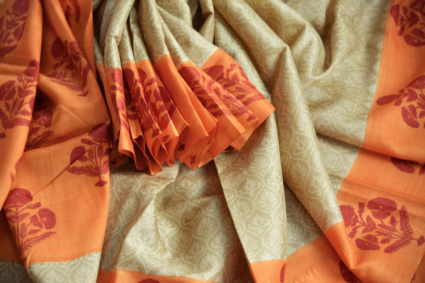 Buy elegant beige printed tussar silk sari online in USA with orange printed border. The saree is an evergreen piece for a regular saree style. If you are looking for Indian handloom sarees in USA, then Pure Elegance is the place for you. Shop online or visit our exclusive fashion store in USA.-details