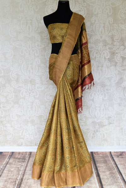 Strike an everlasting impression in our handprinted Tussar silk sari. This yellow coloured elegant silk saree is a work must-have. Shop the beautiful Tussar silk saree, traditional sarees, designer silk sarees online or visit Pure Elegance store in USA. -full view
