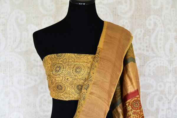 Strike an everlasting impression in our handprinted Tussar silk sari. This yellow coloured elegant silk saree is a work must-have. Shop the beautiful Tussar silk saree, traditional sarees, designer silk sarees online or visit Pure Elegance store in USA. -blouse pallu
