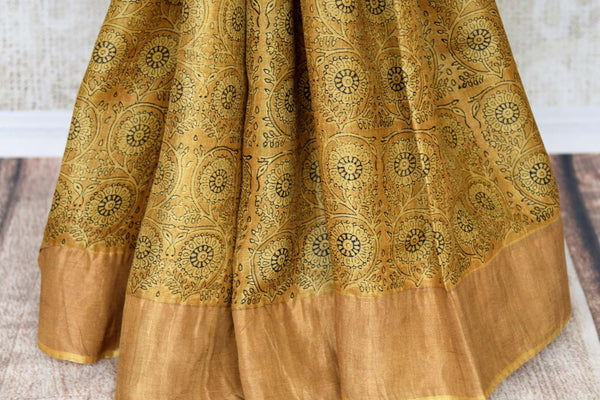 Strike an everlasting impression in our handprinted Tussar silk sari. This yellow coloured elegant silk saree is a work must-have. Shop the beautiful Tussar silk saree, traditional sarees, designer silk sarees online or visit Pure Elegance store in USA. -pleats