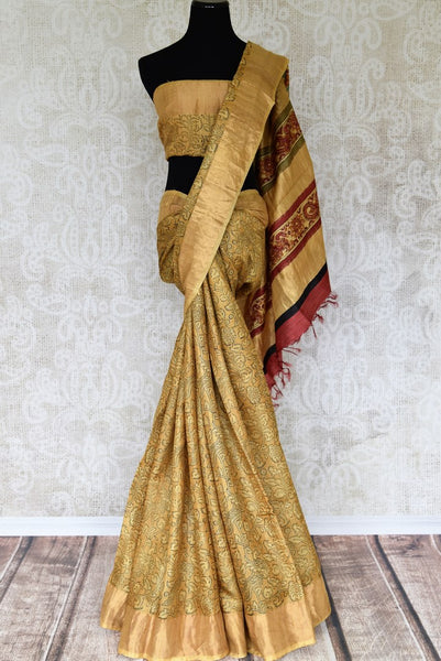 Buy beautiful hand printed tribal art handloom designer silk sarees. These exclusive Tussar silk saris have a matching printed blouse with an embroidered pallu. Shop this classy Indian saree, kalamkari sarees, designer saris online or visit Pure Elegance store in USA. -full view