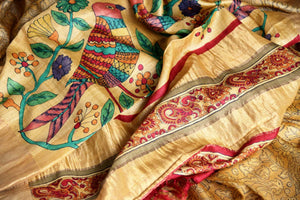 Buy beautiful hand printed tribal art handloom designer silk sarees. These exclusive Tussar silk saris have a matching printed blouse with an embroidered pallu. Shop this classy Indian saree, kalamkari sarees, designer saris online or visit Pure Elegance store in USA. -details