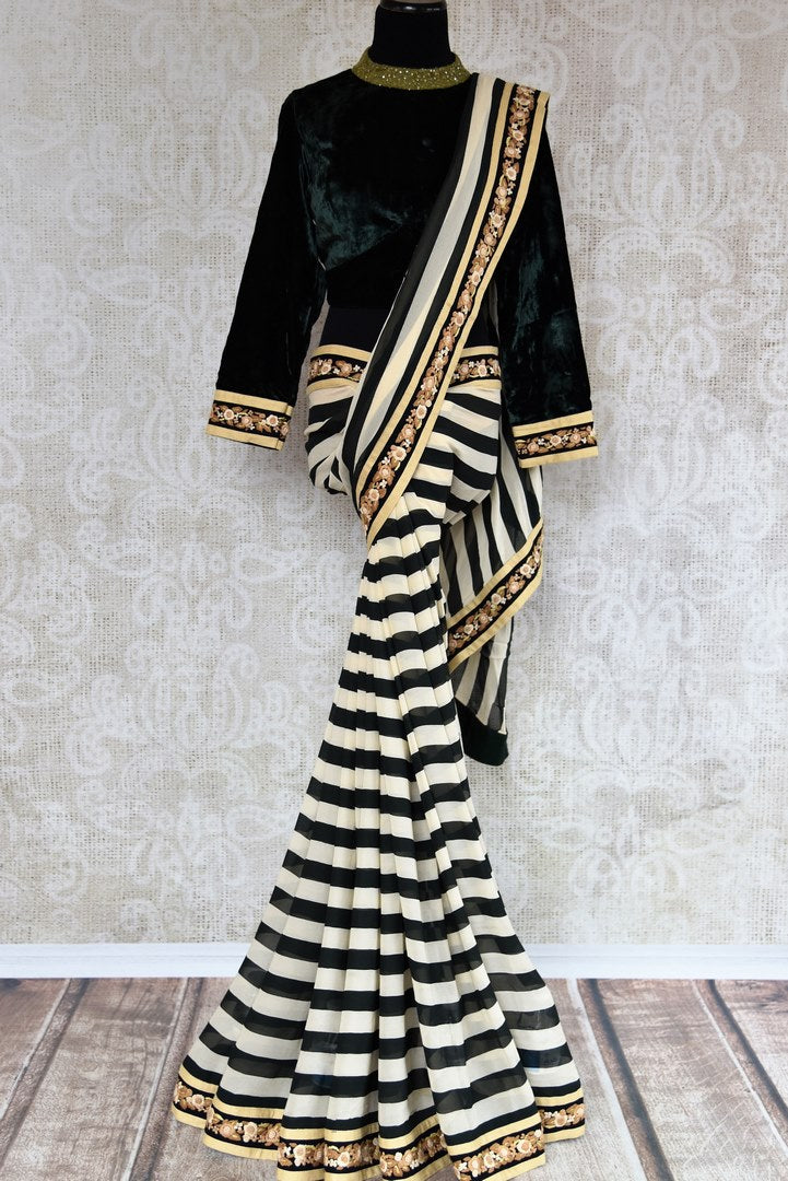 Black and white striped embroidered georgette saree buy online in USA with velvet blouse. Beautifully designed saree is a stylish choice for special occasions. Shop Indian designer sarees with blouses in USA from an alluring collection available at Pure Elegance fashion store.-full view