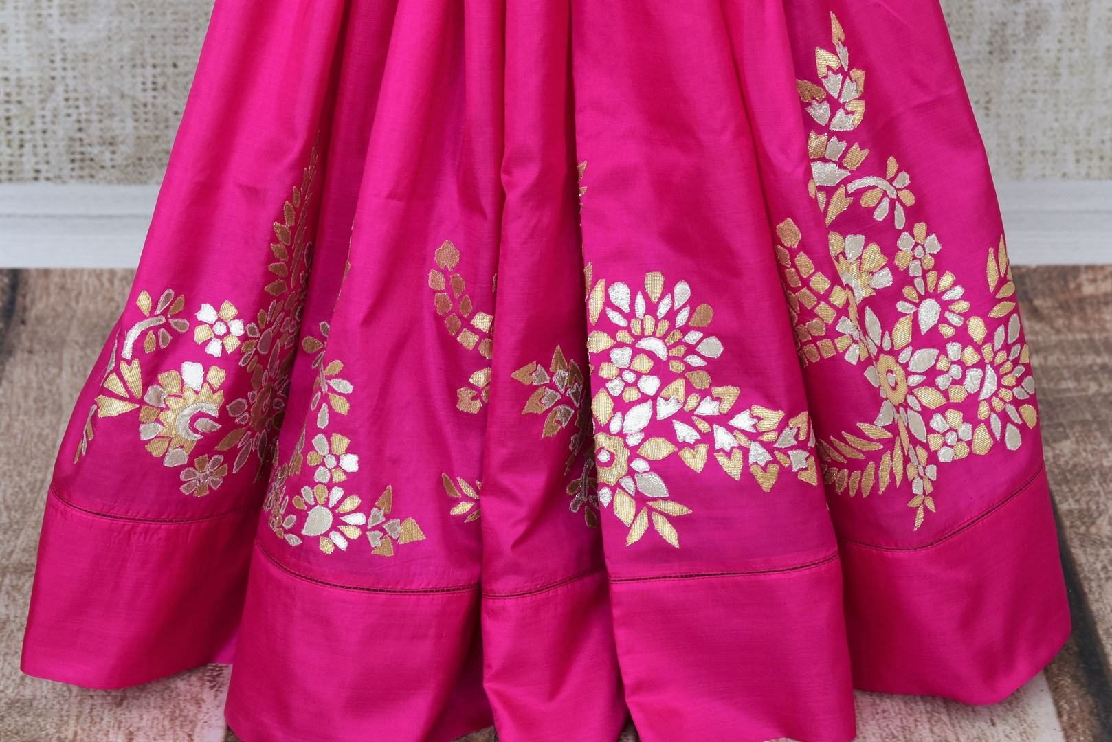Pink applique work silk saree buy online in USA. The saree comes with a stunning red saree blouse which elevates the style quotient of the sari. If you are looking for Indian designer sarees in USA, then Pure Elegance clothing store is your one stop solution, shop now.-pleats