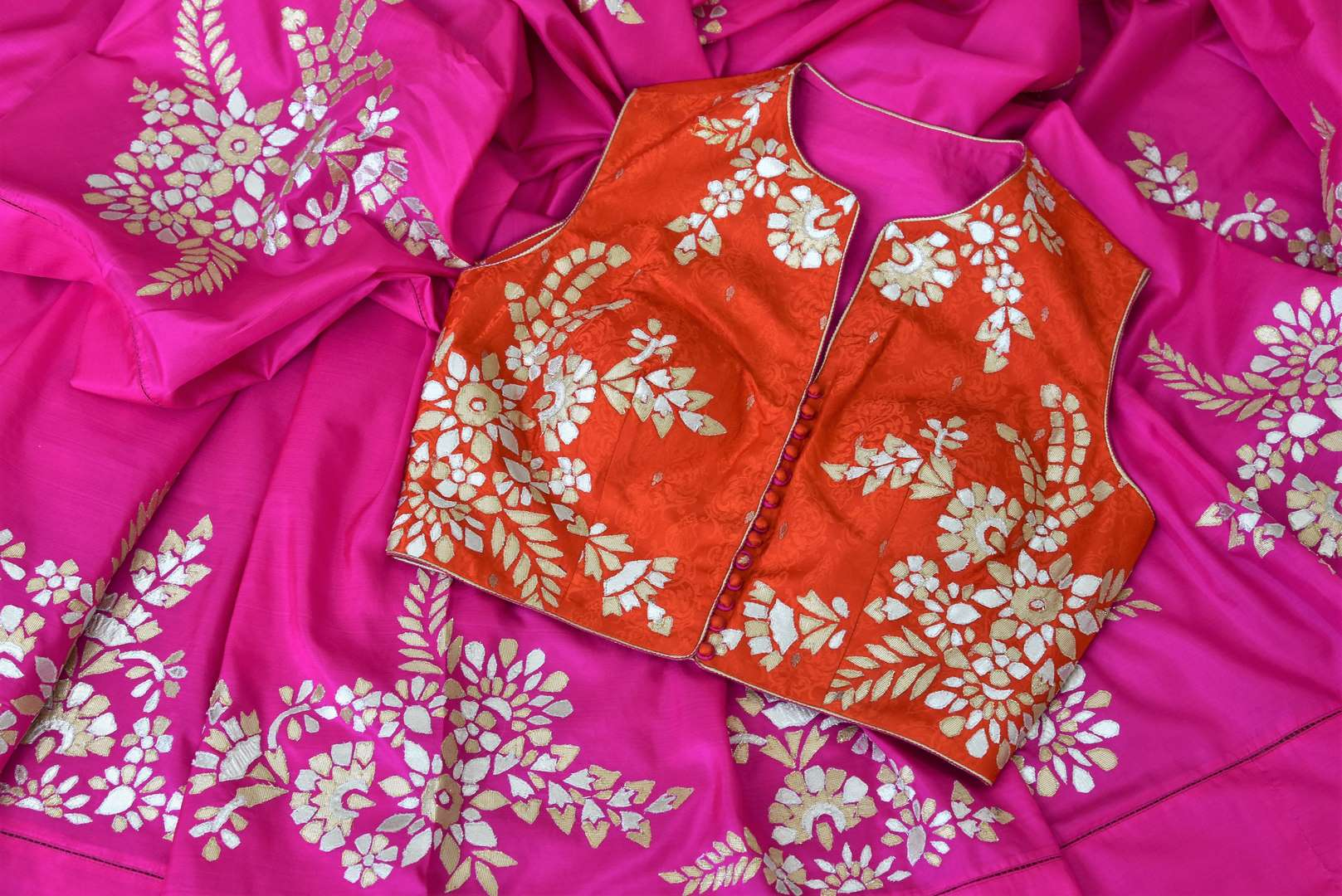 Pink applique work silk saree buy online in USA. The saree comes with a stunning red saree blouse which elevates the style quotient of the sari. If you are looking for Indian designer sarees in USA, then Pure Elegance clothing store is your one stop solution, shop now.-details