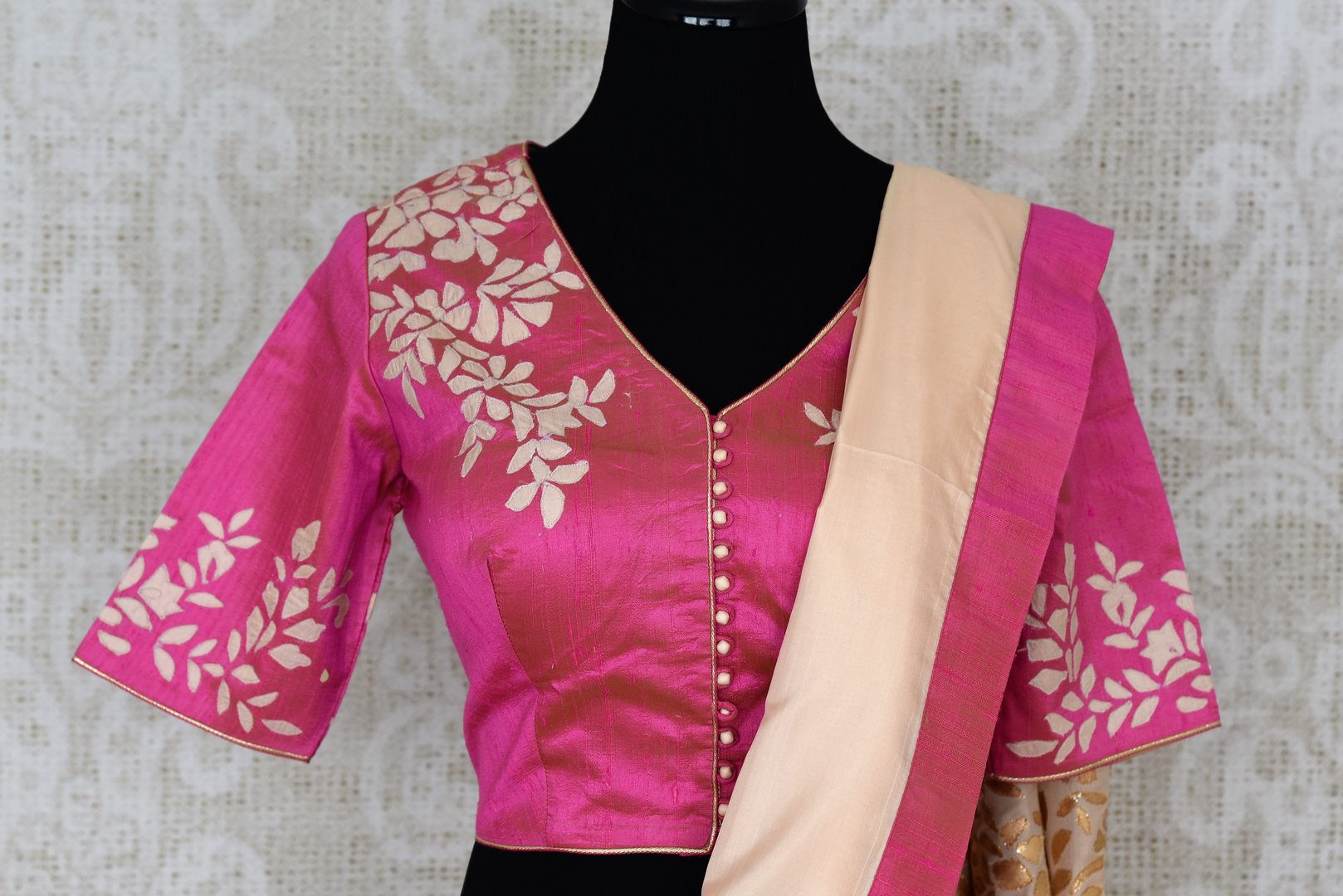 Peach applique work silk sari buy online in USA. The saree comes with a stunning pink sari blouse which elevates the style quotient of the saree. If you are looking for Indian designer saris in USA, then Pure Elegance clothing store is your one-stop solution, shop now.-blouse pallu