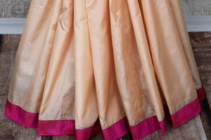 Peach applique work silk sari buy online in USA. The saree comes with a stunning pink sari blouse which elevates the style quotient of the saree. If you are looking for Indian designer saris in USA, then Pure Elegance clothing store is your one-stop solution, shop now.-pleats