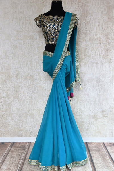 Blue ticki work georgette sari buy online in USA with embroidered saree blouse. Beautifully designed saree is a captivating choice for special occasions. Shop Indian designer saris with blouses in USA from an alluring collection available at Pure Elegance fashion store.-full view