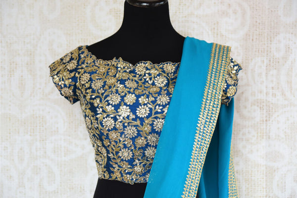 Blue ticki work georgette sari buy online in USA with embroidered saree blouse. Beautifully designed saree is a captivating choice for special occasions. Shop Indian designer saris with blouses in USA from an alluring collection available at Pure Elegance fashion store.-blouse pallu