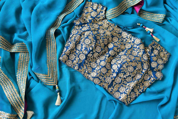 Blue ticki work georgette sari buy online in USA with embroidered saree blouse. Beautifully designed saree is a captivating choice for special occasions. Shop Indian designer saris with blouses in USA from an alluring collection available at Pure Elegance fashion store.-details