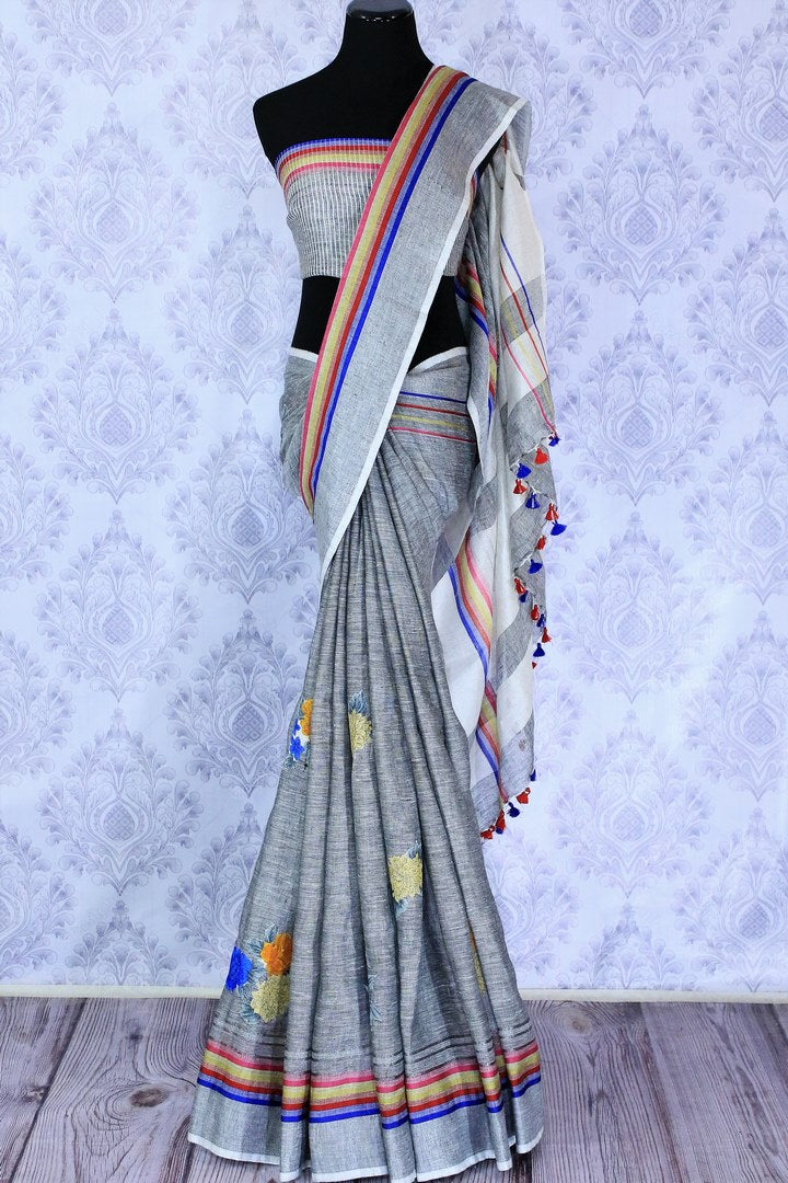 Buy stylish grey linen saree online in USA with floral applique work. The saree is an alluring choice for summer parties and special occasions. Buy more such Indian woven saris in USA at Pure Elegance exclusive fashion store or shop online at the comfort of your home.-full view