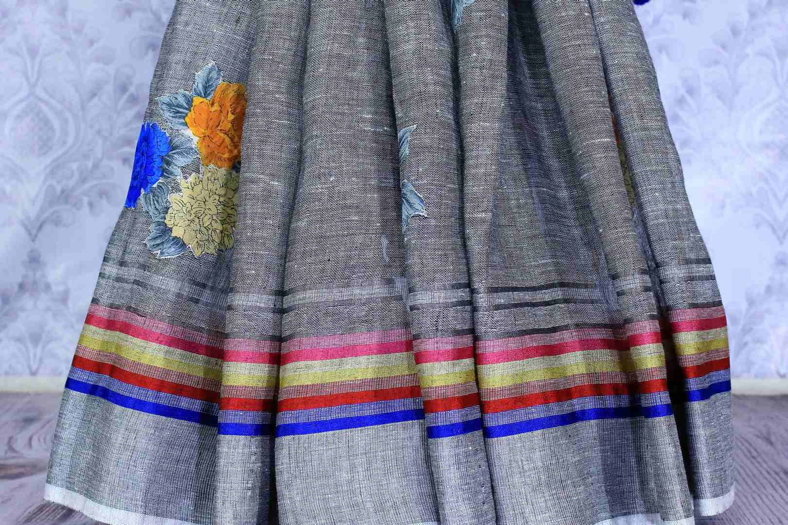 Buy stylish grey linen saree online in USA with floral applique work. The saree is an alluring choice for summer parties and special occasions. Buy more such Indian woven saris in USA at Pure Elegance exclusive fashion store or shop online at the comfort of your home.-pleats