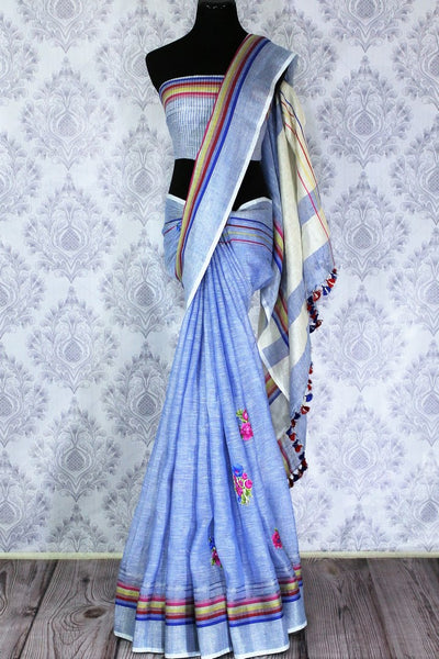 Buy elegant light blue linen saree online in USA with floral applique work. The saree is an alluring choice for summer parties and special occasions. Buy more such Indian handloom saris in USA at Pure Elegance exclusive fashion store or shop online at the comfort of your home.-full view
