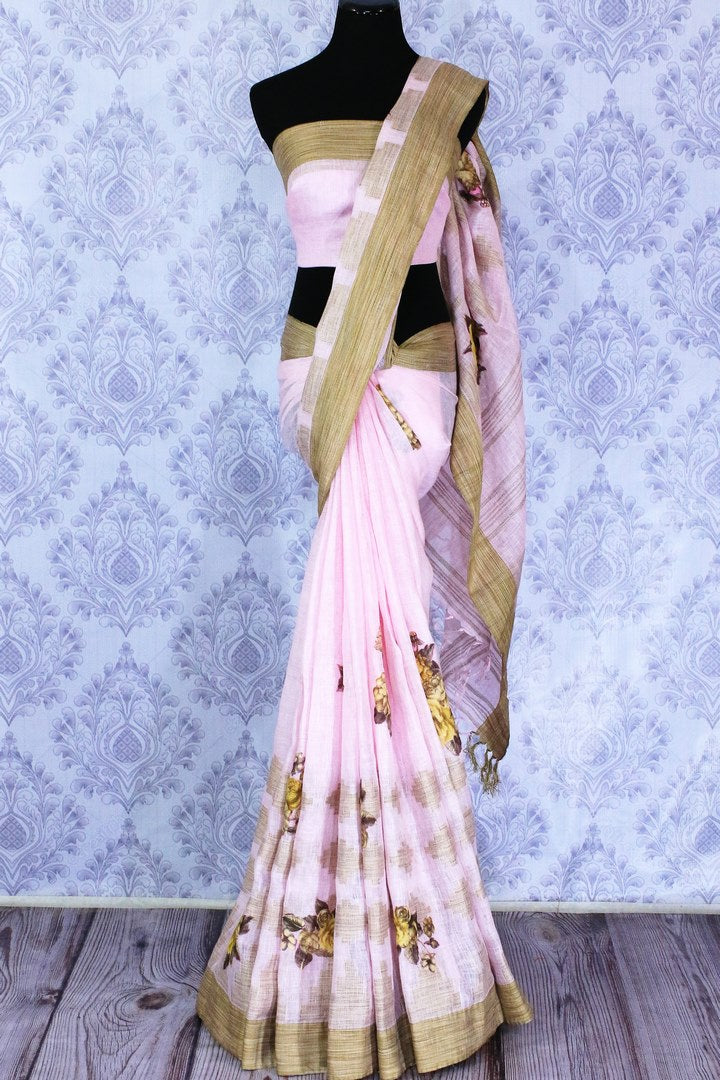 Buy baby pink linen saree online in USA with floral applique work. The saree is an alluring choice for summer parties and special occasions. Buy more such Indian handloom saris, pure linen sarees in USA at Pure Elegance exclusive fashion store or shop online at the comfort of your home.-full view