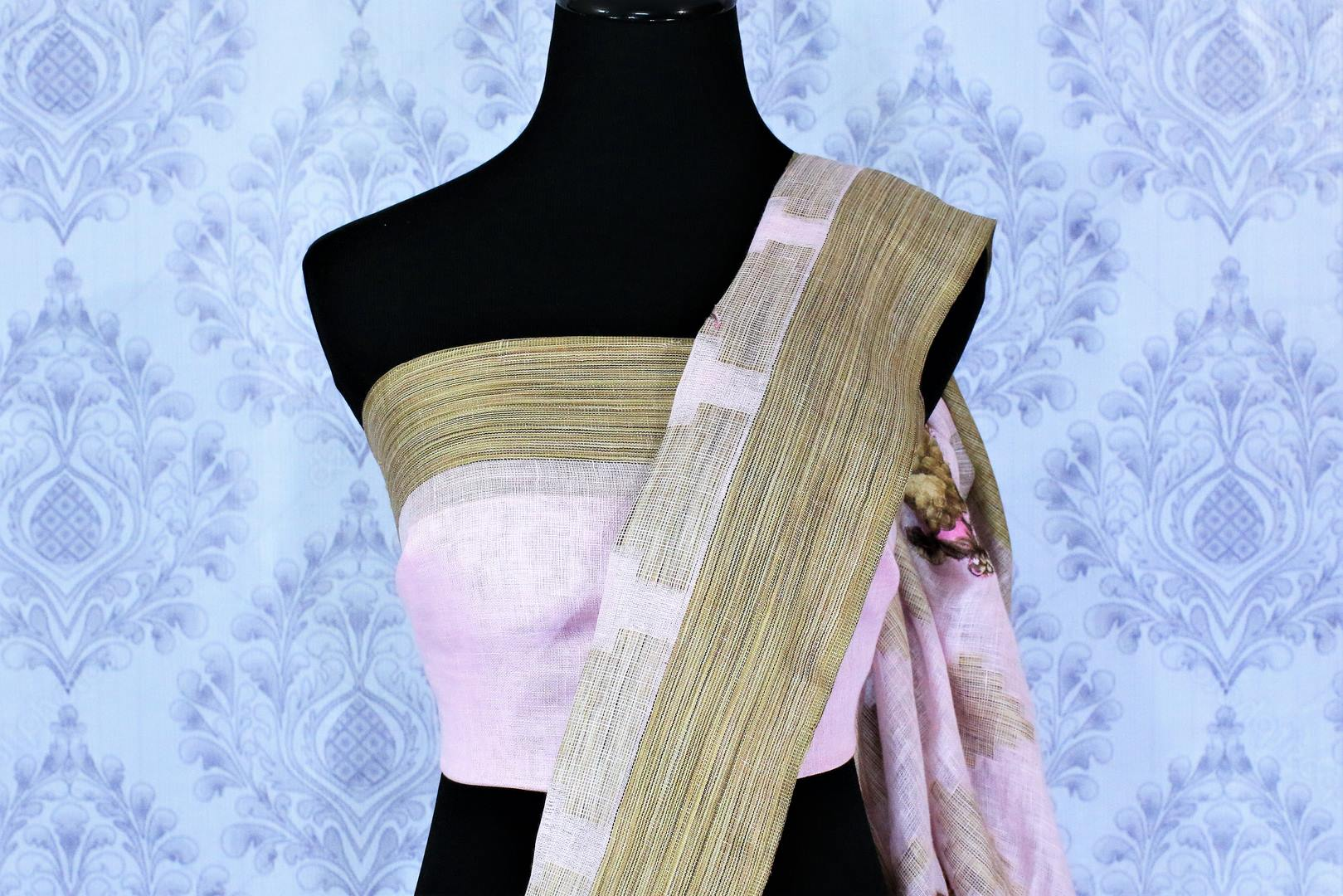 Buy baby pink linen saree online in USA with floral applique work. The saree is an alluring choice for summer parties and special occasions. Buy more such Indian handloom saris, pure linen sarees in USA at Pure Elegance exclusive fashion store or shop online at the comfort of your home.-blouse pallu