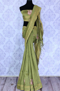 Buy olive green woven tussar saree online in USA with applique work. The saree is an alluring choice for summer parties and special occasions. Buy more such Indian handloom sarees, pure tussar sarees in USA at Pure Elegance exclusive fashion store or shop online at the comfort of your home.-full view