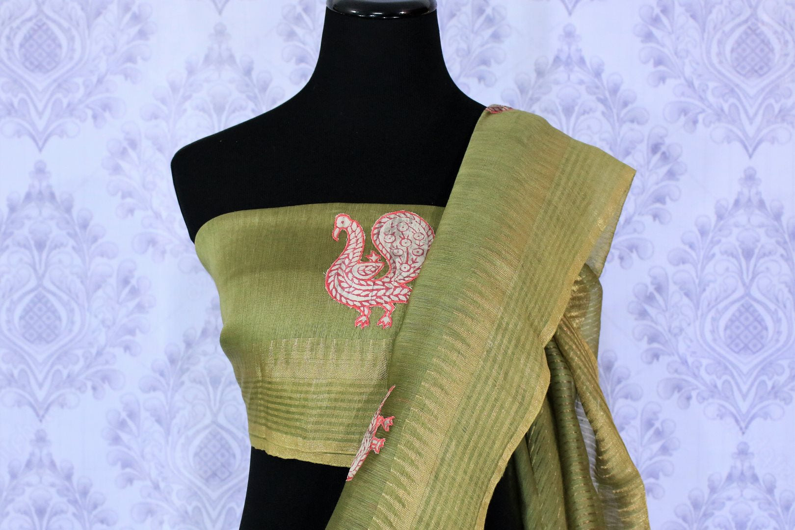 Buy olive green woven tussar saree online in USA with applique work. The saree is an alluring choice for summer parties and special occasions. Buy more such Indian handloom sarees, pure tussar sarees in USA at Pure Elegance exclusive fashion store or shop online at the comfort of your home.-blouse pallu