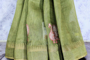 Buy olive green woven tussar saree online in USA with applique work. The saree is an alluring choice for summer parties and special occasions. Buy more such Indian handloom sarees, pure tussar sarees in USA at Pure Elegance exclusive fashion store or shop online at the comfort of your home.-pleats