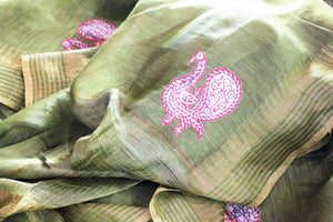 Buy olive green woven tussar saree online in USA with applique work. The saree is an alluring choice for summer parties and special occasions. Buy more such Indian handloom sarees, pure tussar sarees in USA at Pure Elegance exclusive fashion store or shop online at the comfort of your home.-details