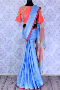 Buy light blue linen saree online in USA with embroidered saree blouse. The saree is an alluring choice for summer parties and special occasions. Buy more such Indian handloom sarees, sarees with blouses in USA at Pure Elegance exclusive fashion store or shop online at the comfort of your home.-full view