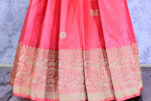 Buy pink Benarasi silk saree online in USA with embroidered sari blouse. The saree is an alluring choice for a traditional look at weddings and special occasions. Buy more such Indian designer sarees, silk sarees in USA at Pure Elegance exclusive fashion store or shop online at the comfort of your home.-pleats