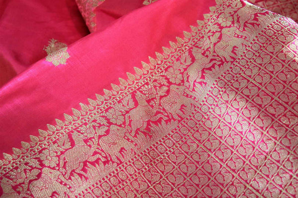 Buy pink Benarasi silk saree online in USA with embroidered sari blouse. The saree is an alluring choice for a traditional look at weddings and special occasions. Buy more such Indian designer sarees, silk sarees in USA at Pure Elegance exclusive fashion store or shop online at the comfort of your home.-details