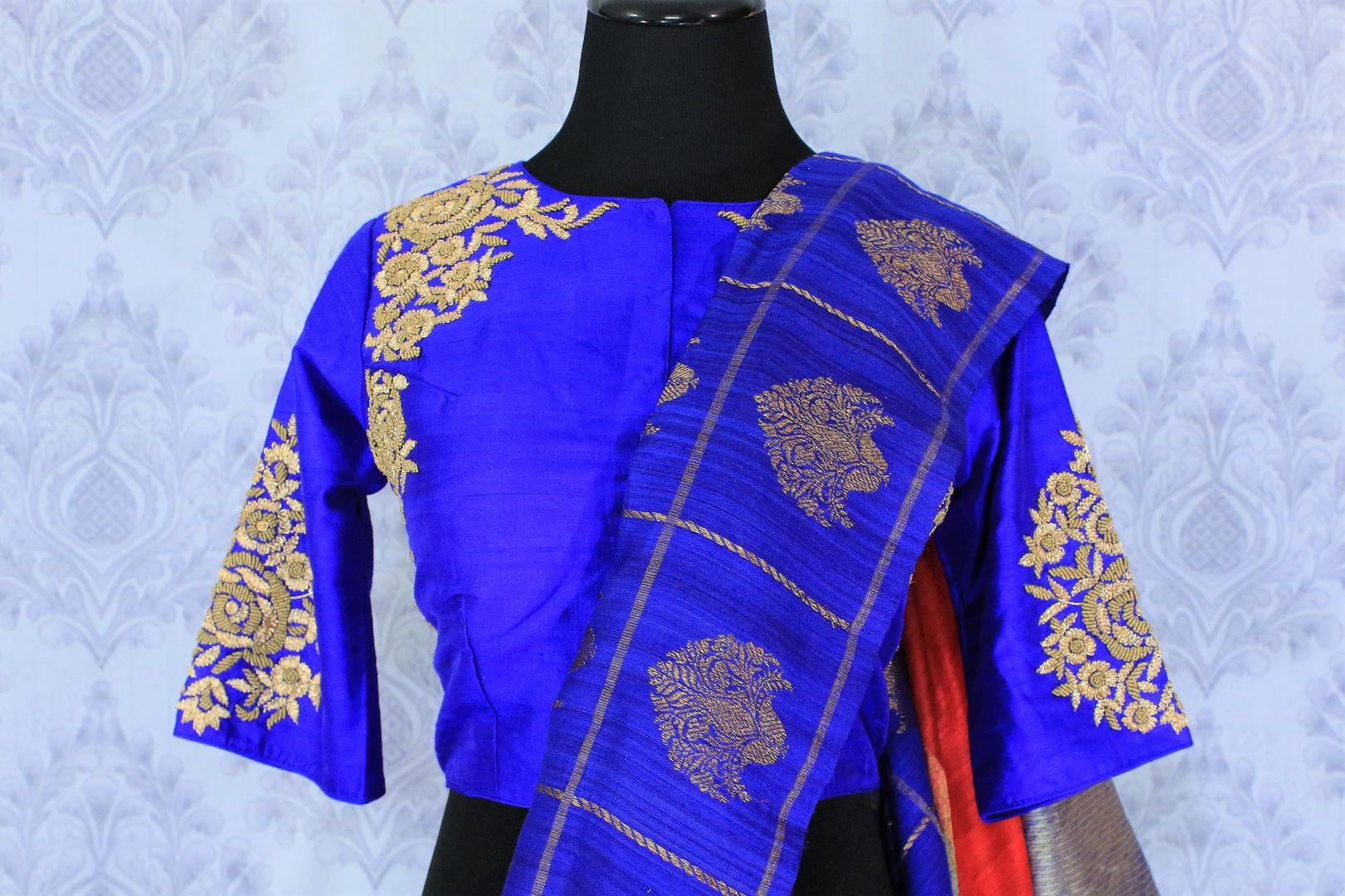 Buy red and blue tussar Benarasi saree online in USA with embroidered sari blouse. The saree is an alluring choice for a traditional look at weddings and special occasions. Buy more such Indian designer sarees, silk saris in USA at Pure Elegance exclusive fashion store or shop online at the comfort of your home.-blouse pallu