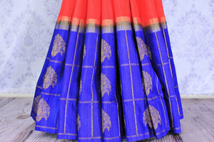 Buy red and blue tussar Benarasi saree online in USA with embroidered sari blouse. The saree is an alluring choice for a traditional look at weddings and special occasions. Buy more such Indian designer sarees, silk saris in USA at Pure Elegance exclusive fashion store or shop online at the comfort of your home.-pleats