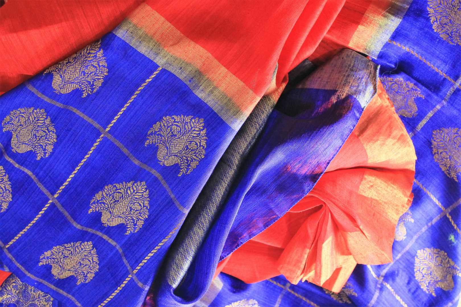 Buy red and blue tussar Benarasi saree online in USA with embroidered sari blouse. The saree is an alluring choice for a traditional look at weddings and special occasions. Buy more such Indian designer sarees, silk saris in USA at Pure Elegance exclusive fashion store or shop online at the comfort of your home.-details