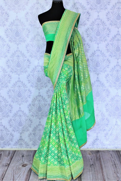 Beautiful green khaddi Banarasi georgette saree buy online in USA. The saree is a perfect choice for a traditional look at special occasions. Buy more such Indian designer saris in USA at Pure Elegance exclusive fashion store or shop online at the comfort of your home.-full view