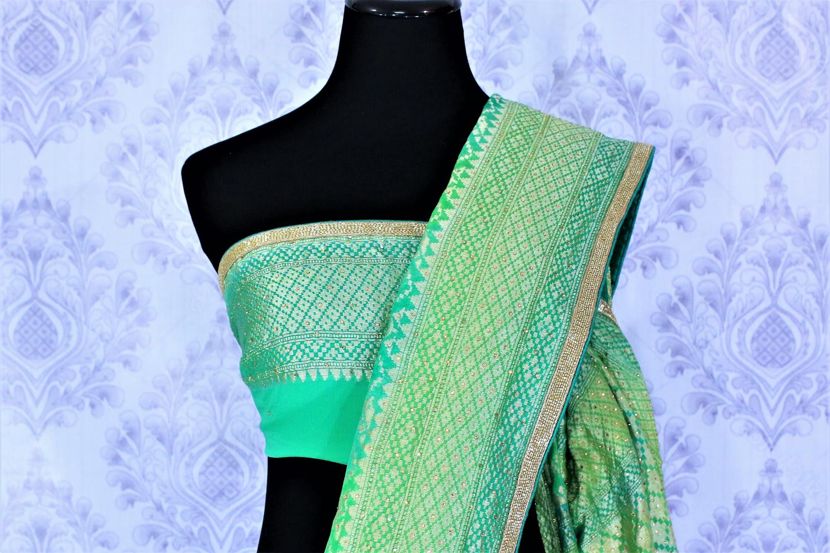 Beautiful green khaddi Banarasi georgette saree buy online in USA. The saree is a perfect choice for a traditional look at special occasions. Buy more such Indian designer saris in USA at Pure Elegance exclusive fashion store or shop online at the comfort of your home.-blouse pallu