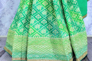 Beautiful green khaddi Banarasi georgette saree buy online in USA. The saree is a perfect choice for a traditional look at special occasions. Buy more such Indian designer saris in USA at Pure Elegance exclusive fashion store or shop online at the comfort of your home.-pleats