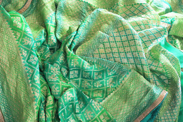 Beautiful green khaddi Banarasi georgette saree buy online in USA. The saree is a perfect choice for a traditional look at special occasions. Buy more such Indian designer saris in USA at Pure Elegance exclusive fashion store or shop online at the comfort of your home.-details