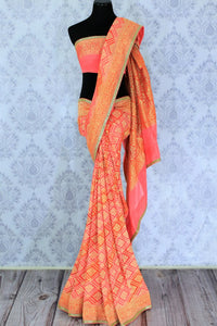 Buy beautiful orange khaddi Banarasi georgette sari online in USA. The saree is a perfect choice for a traditional look at special occasions. Buy more such Indian Banarasi sarees in USA at Pure Elegance exclusive fashion store or shop online at the comfort of your home.-full view