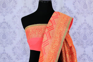 Buy beautiful orange khaddi Banarasi georgette sari online in USA. The saree is a perfect choice for a traditional look at special occasions. Buy more such Indian Banarasi sarees in USA at Pure Elegance exclusive fashion store or shop online at the comfort of your home.-blouse pallu