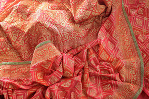 Buy beautiful orange khaddi Banarasi georgette sari online in USA. The saree is a perfect choice for a traditional look at special occasions. Buy more such Indian Banarasi sarees in USA at Pure Elegance exclusive fashion store or shop online at the comfort of your home.-details