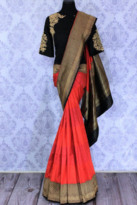 Buy red and black Banarasi silk saree online in USA with embroidered sari blouse. The saree is an alluring choice for a traditional look at weddings and special occasions. Buy more such Indian designer sarees in USA at Pure Elegance exclusive fashion store or shop online at the comfort of your home.-full view