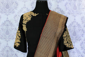 Buy red and black Banarasi silk saree online in USA with embroidered sari blouse. The saree is an alluring choice for a traditional look at weddings and special occasions. Buy more such Indian designer sarees in USA at Pure Elegance exclusive fashion store or shop online at the comfort of your home.-blouse pallu