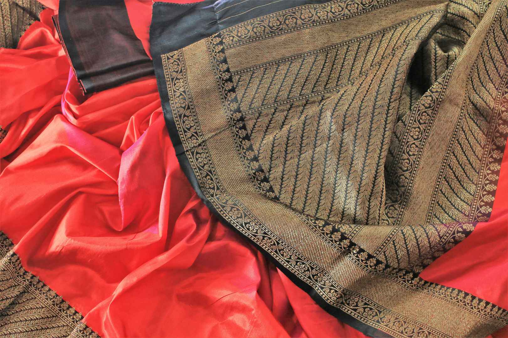 Buy red and black Banarasi silk saree online in USA with embroidered sari blouse. The saree is an alluring choice for a traditional look at weddings and special occasions. Buy more such Indian designer sarees in USA at Pure Elegance exclusive fashion store or shop online at the comfort of your home.-details