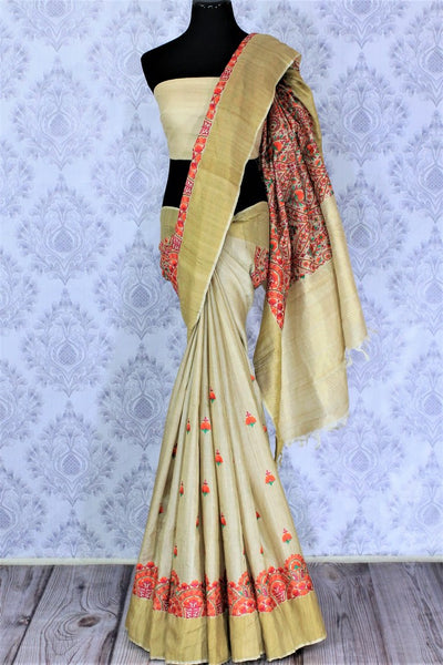 Buy elegant beige tussar silk saree online in USA with embroidery. The saree is a perfect choice for an ethnic saree look at special occasions. Buy more such Indian woven sarees in USA at Pure Elegance exclusive fashion store or shop online at the comfort of your home.-full view