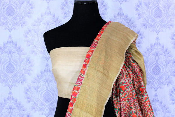Buy elegant beige tussar silk saree online in USA with embroidery. The saree is a perfect choice for an ethnic saree look at special occasions. Buy more such Indian woven sarees in USA at Pure Elegance exclusive fashion store or shop online at the comfort of your home-blouse pallu