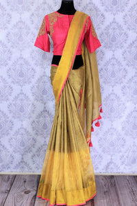Buy golden brown kota silk saree online in USA with embroidered blouse. The saree is an alluring choice for a traditional look at special occasions. Buy more such Indian designer saris in USA at Pure Elegance exclusive fashion store or shop online at the comfort of your home.-full view