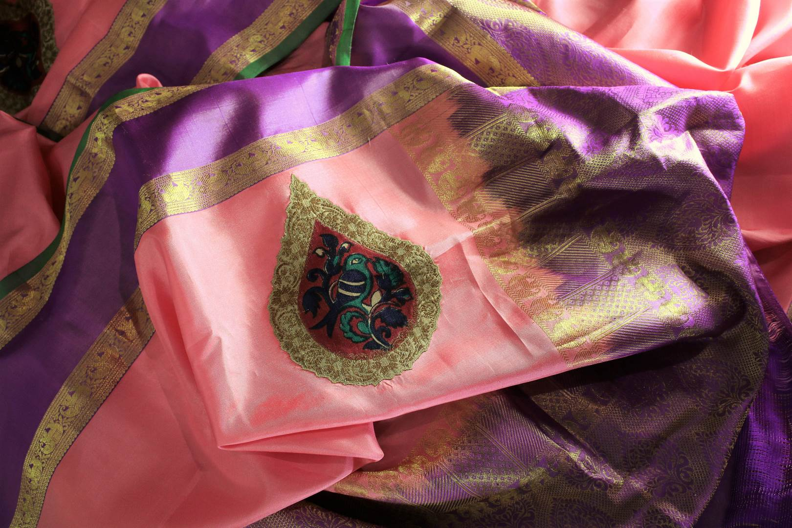 Buy beautiful pink Banarasi silk sari online in USA with applique work. The saree is a perfect choice for a beautiful Indian look at special occasions. Buy more such Indian woven sarees, silk sarees in USA at Pure Elegance exclusive fashion store or shop online at the comfort of your home.-details