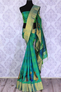 Buy beautiful blue and green Kanjeevaram saree online in USA with applique work. The saree is a perfect choice for a beautiful Indian look at special occasions. Buy more such Indian designer sarees, Kanchipuram silk sarees in USA at Pure Elegance exclusive fashion store or shop online at the comfort of your home.-full view