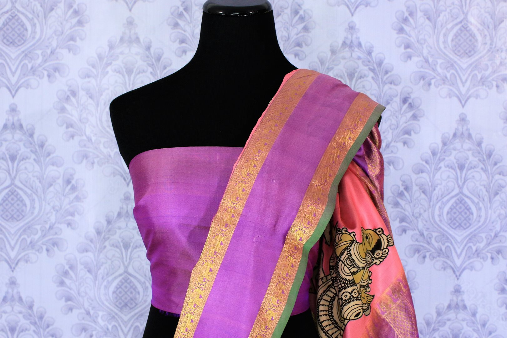 Buy beautiful pink silk saree online in USA with Kalamkari applique work. The saree is a perfect choice for a beautiful Indian look at special occasions. Buy more such Indian designer sarees, silk sarees in USA at Pure Elegance exclusive fashion store or shop online at the comfort of your home.-blouse pallu