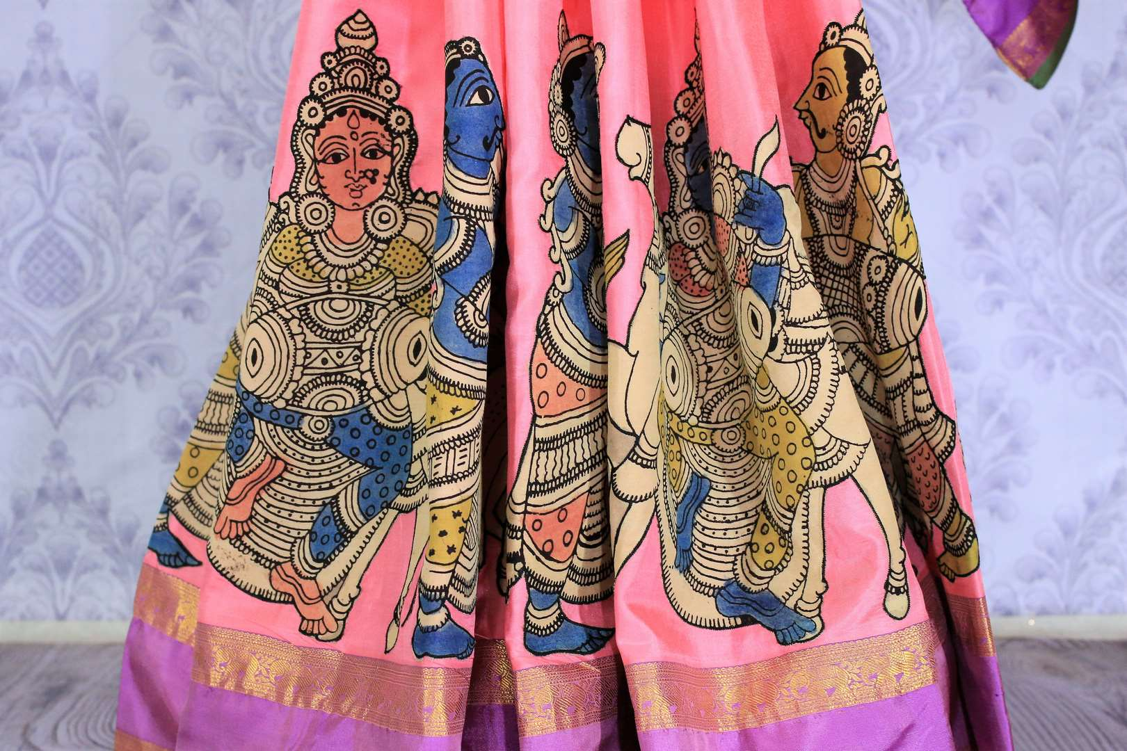 Buy beautiful pink silk saree online in USA with Kalamkari applique work. The saree is a perfect choice for a beautiful Indian look at special occasions. Buy more such Indian designer sarees, silk sarees in USA at Pure Elegance exclusive fashion store or shop online at the comfort of your home.-pleats
