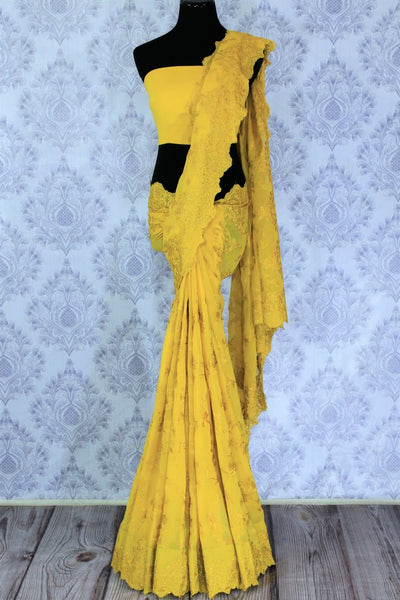 Mustard yellow embroidered georgette saree buy online in USA. The saree is a stylish choice for parties and special occasions. Buy more such Indian designer saris in USA at Pure Elegance exclusive fashion store or shop online at the comfort of your home.-full view