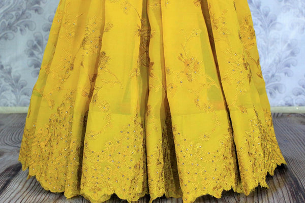 Mustard yellow embroidered georgette saree buy online in USA. The saree is a stylish choice for parties and special occasions. Buy more such Indian designer saris in USA at Pure Elegance exclusive fashion store or shop online at the comfort of your home.-pleats