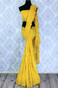 Buy alluring yellow embroidered georgette saree online in USA. Dazzle in this vibrant color saree with delicate embroidery at parties and special occasions. Make your party look special with beautiful Indian designer sarees available at Pure Elegance Indian clothing store in USA or shop online.-full view