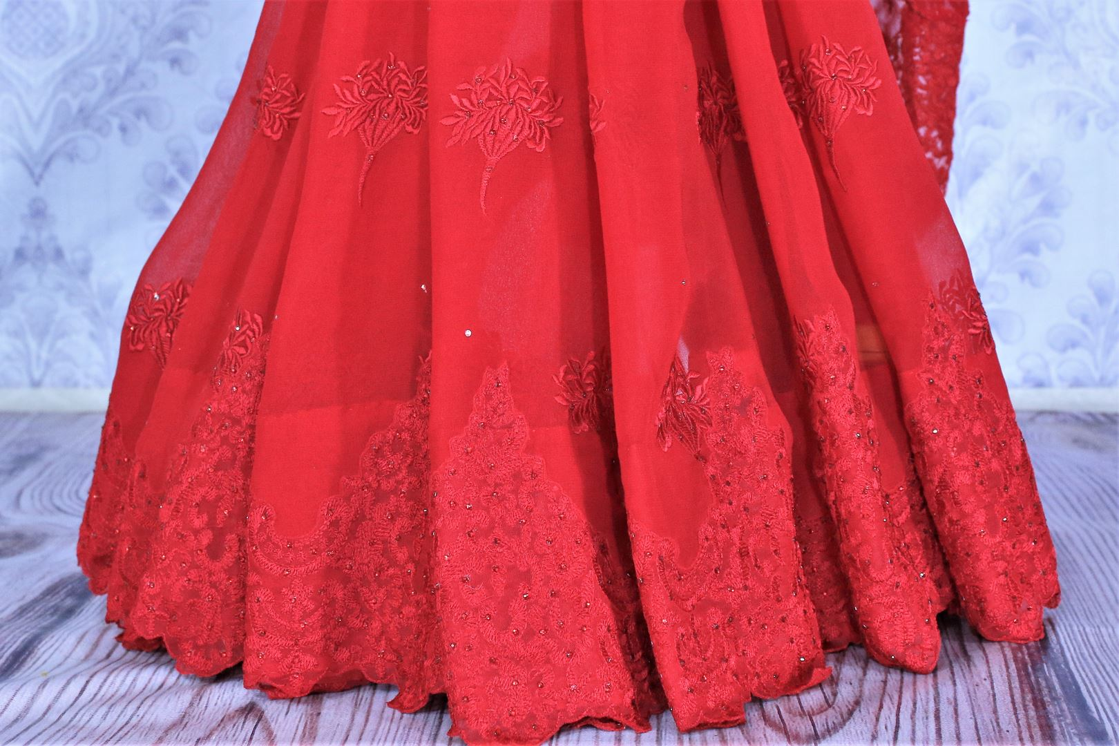 Buy bright red embroidered georgette saree online in USA. Dazzle in this bright color saree with delicate embroidery at parties and special occasions. Make your party look special with beautiful Indian designer sarees available at Pure Elegance Indian clothing store in USA or shop online.-pleats